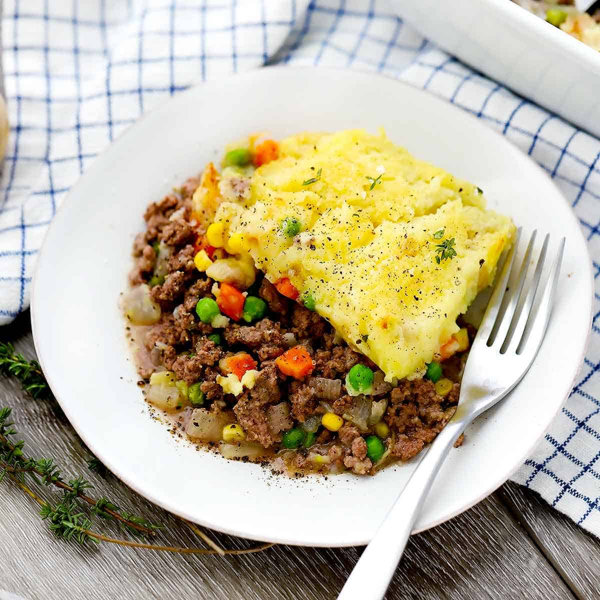 A plate of cottage pie and a fork.