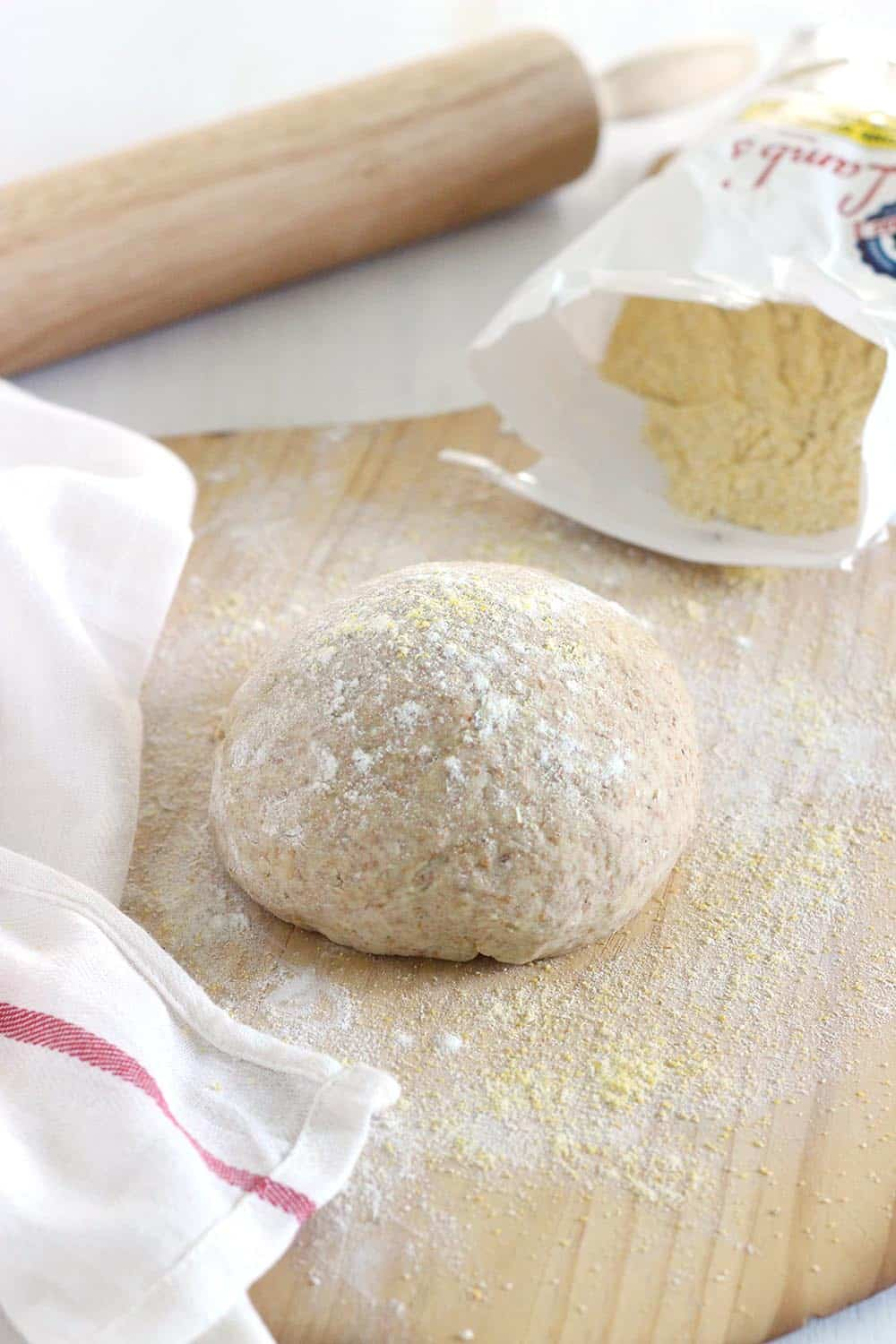 A whole wheat pizza dough recipe that has a hint of salty-sweet and isn't dry or crumbly. Use for pizza, calzones, or flatbreads.