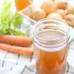 homemade slow-cooker vegetable stock/broth made with kitchen scraps, kept in the freezer until you are ready to use!