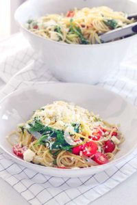 This easy vegetarian pasta dish is packed with arugula, lime, cayenne pepper, feta cheese, parmesan, basil, and tomatoes. It all blends together to give it a unique flavor with an awesome kick!