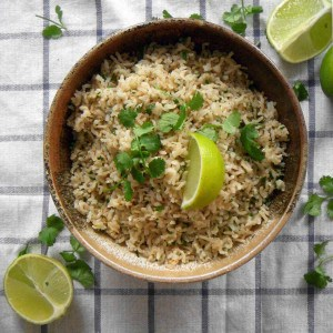 Cilantro Lime Brown Rice | Just like you get at Chipotle! An easy side dish made with only three ingredients. Brown rice is cooked with the zest of one lime, with lime juice and cilantro added at the end.