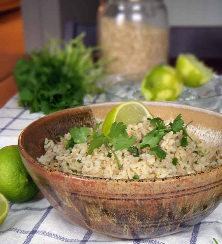 This cilantro lime brown rice is just like you get at Chipotle! An easy side dish made with only three ingredients. Brown rice is cooked with the zest of one lime, with lime juice and cilantro added at the end.