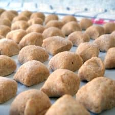 Whole Wheat Ricotta Gnocchi in rows on a work surface.