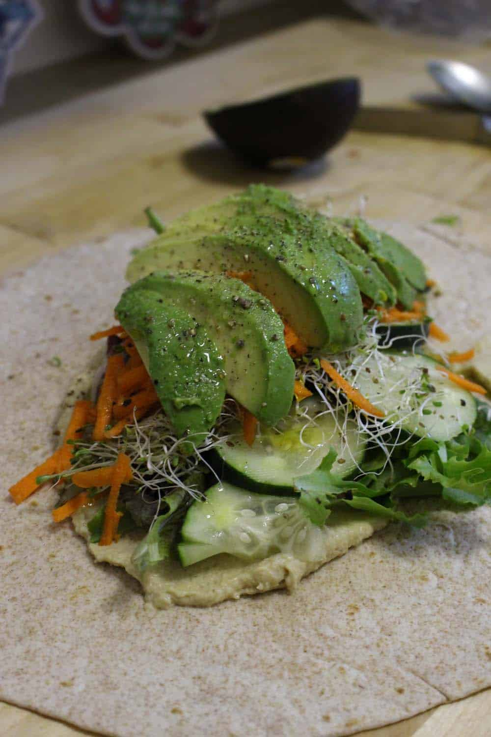 A fresh versatile veggie wrap with hummus, avocado, and a simple dressing added to make extra it satisfying and delicious! Super quick and easy, and VERY healthy.