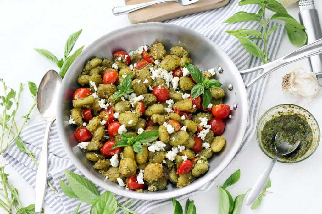 This four ingredient Crispy Pesto Gnocchi with Goat Cheese and Cherry Tomatoes comes together in 15 minutes! The gnocchi are fried until crispy in olive oil, and the goat cheese melts into the pesto sauce creating a rich and creamy texture in this vegetarian recipe.