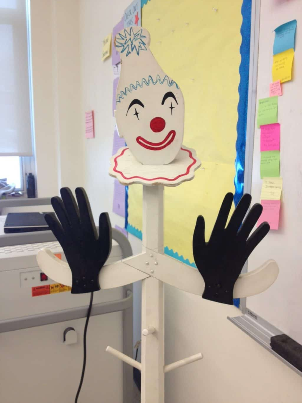 View of classroom with clown made of paper in foreground.
