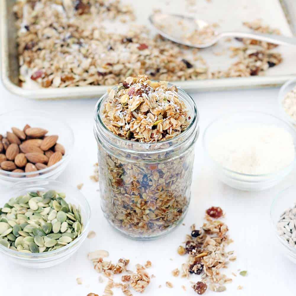This Coconut Granola with Almonds and Cardamom is a nutrient-packed granola recipe sweetened with honey and scented with the warm flavors of cardamom and cinnamon. This will make your house smell beyond amazing as it bakes!