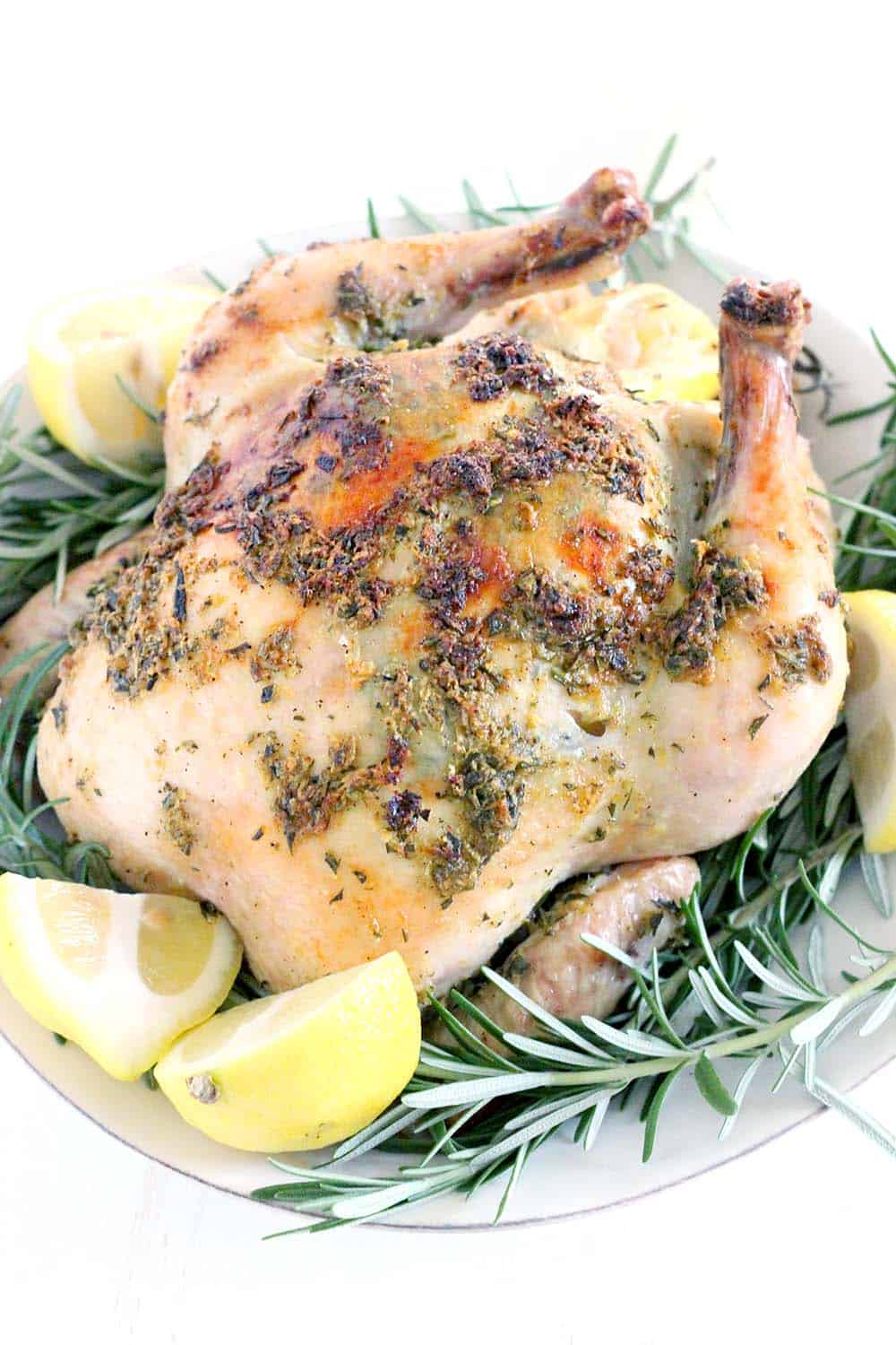 This is the BEST roast chicken recipe EVER! It's cooked in a dutch oven, ensuring crispy skin and juicy meat, and BURSTING with fresh flavor from tons of lemon, rosemary, and garlic. It's easy to make with only six ingredients, and ever single part of each ingredient is used, so there is no waste.