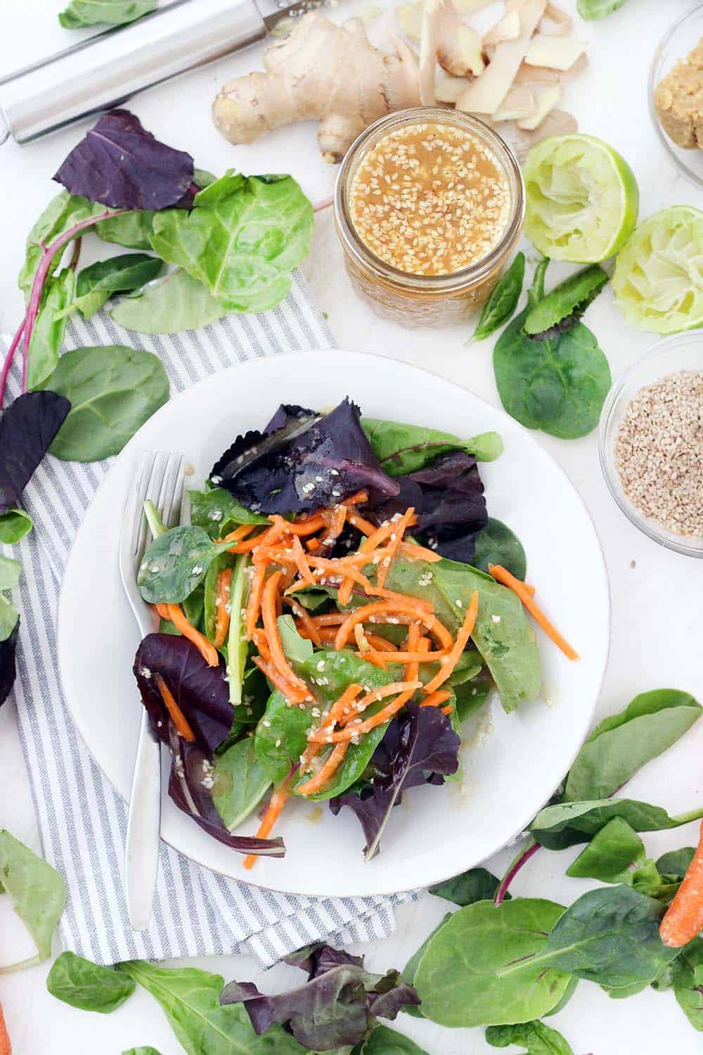 This Miso Sesame Ginger Dressing packs a ton of flavor and nutritional punch- the sesame and fresh ginger pair together so well, it's made tangy by the lime juice and vinegar, and emulsified by the miso, which adds a salty umami to the dressing.