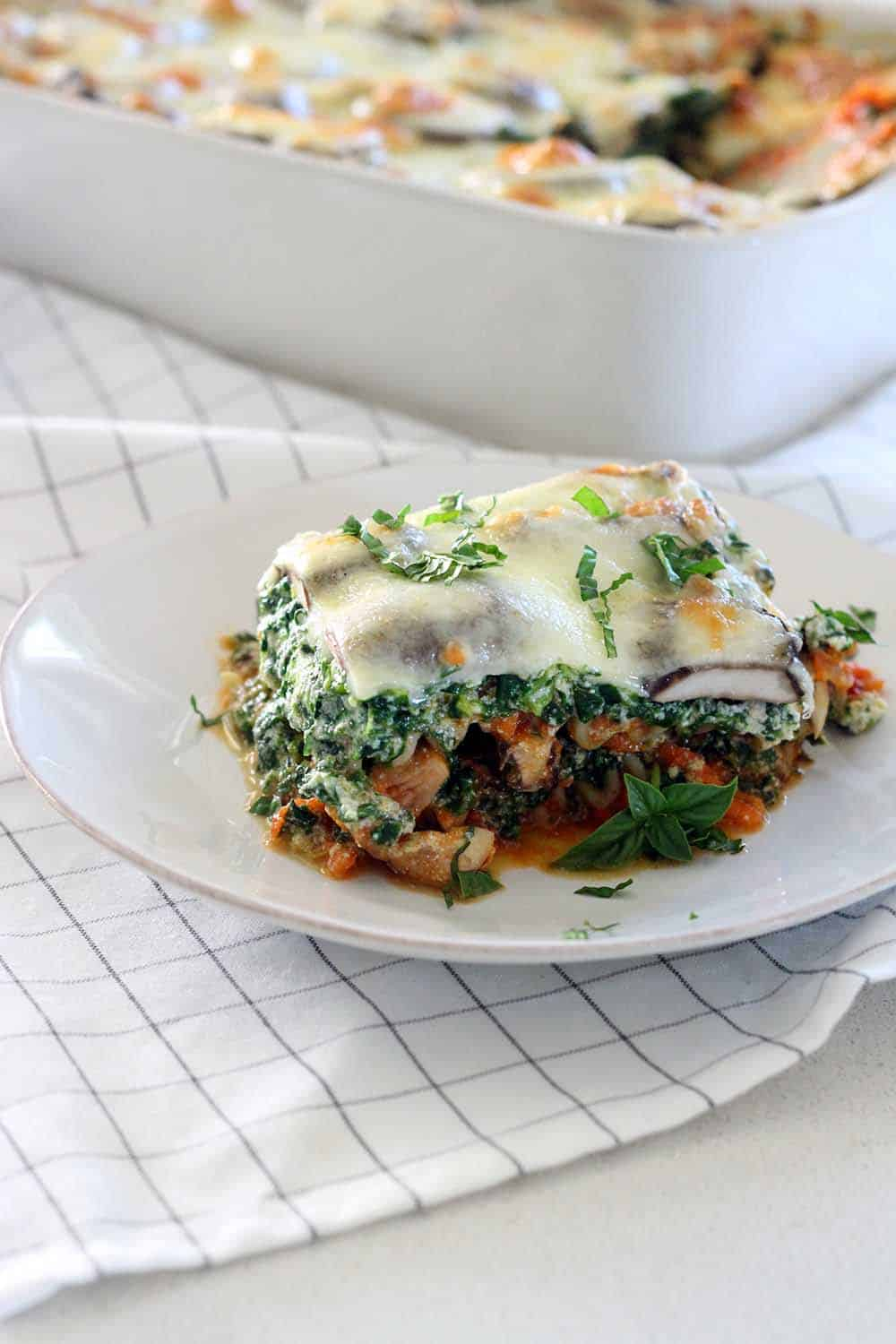 This vegetarian lasagna will satisfy even the most meat-loving carnivores. It's PACKED with good for you veggies, and it can be made well in advance and frozen for an easy make-ahead meal!