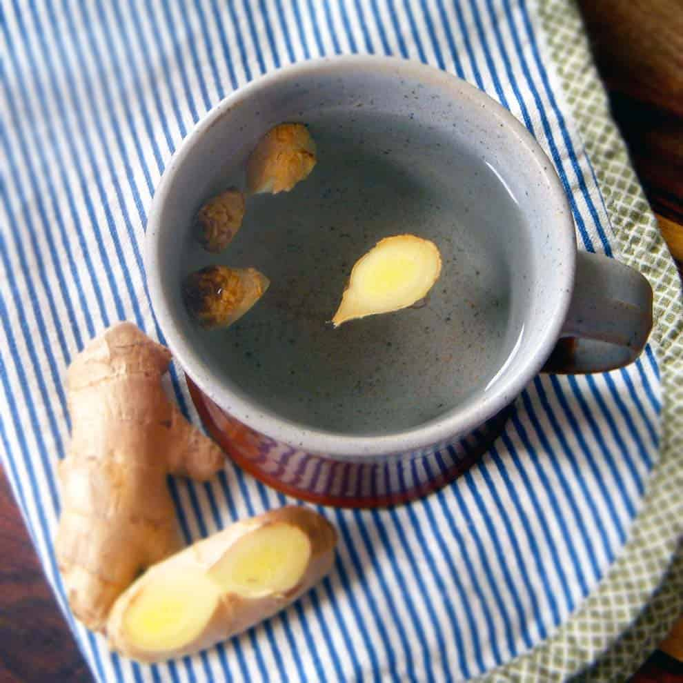 Fresh ginger tea made simply by pouring hot water over slices of fresh ginger! Healthier, fresher, and more delicious than store-bought ginger tea.