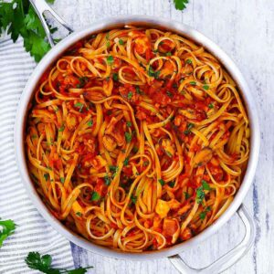 Linguine Fra Diavolo   A spicy red sauce with mixed seafood over linguine. This recipe is so simple, so delicious, and takes four ingredients and 15 minutes to make!