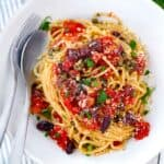 Pasta Puttanesca | Whole wheat pasta with a quick and easy puttanesca sauce- a spicy, salty tomato sauce made with capers, olives, and anchovies.
