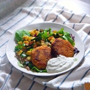 Salmon Croquettes with Lemon-Dill Sauce | Delicious salmon patties made with canned salmon. Very budget-friendly and versatile; can be eaten on their own, in salad, sandwiches, as a burger alternative, or on top of pasta!