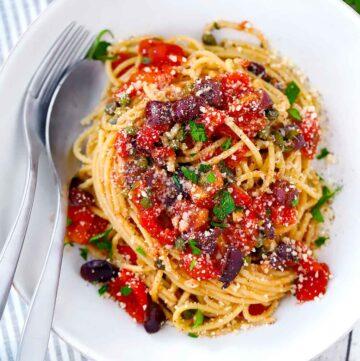 Square photo of spaghetti alla puttanesca.
