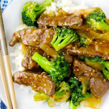 Beef and broccoli on a plate with chopsticks