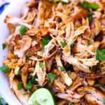 Smoky Mexican Pulled Chicken | This chicken is juicy and bursting with smoky flavor. Enjoy on its own with a side of rice and beans or use in enchiladas, burritos, salads, tacos, tortilla soup... or any other favorite mexican dish that requires chicken!
