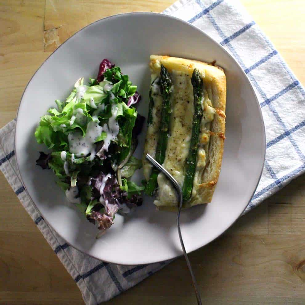Asparagus Tart with Goat Cheese and Gruyere | Fresh spring asparagus atop buttery puff pastry, creamy goat cheese, and shredded gruyere. Simple, elegant, and oh so tasty.