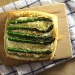 Fresh spring asparagus atop buttery puff pastry, creamy goat cheese, and shredded gruyere. Simple, elegant, and oh so tasty.