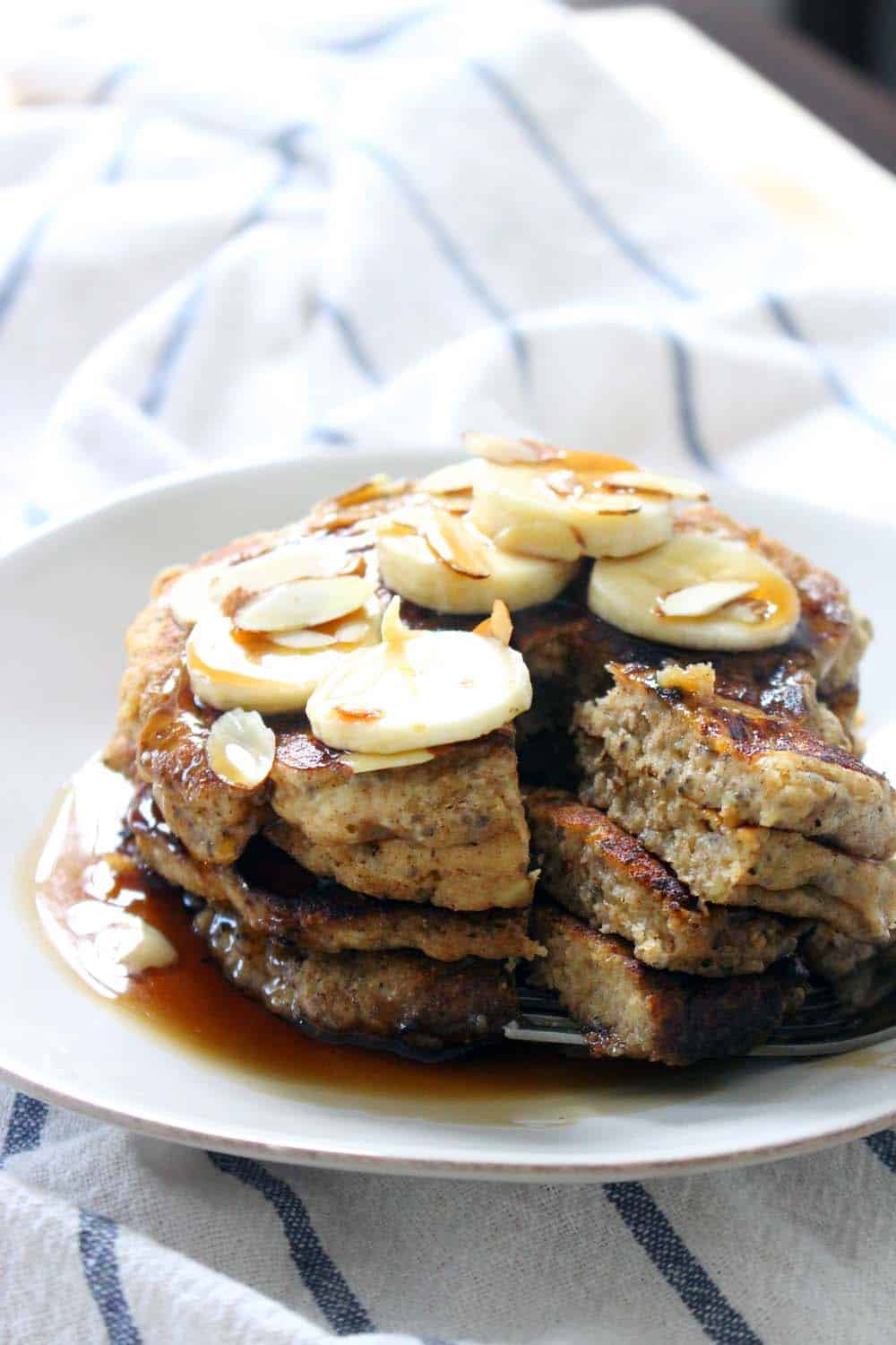 Banana Chia Seed Pancakes | Hearty, delicious, and fluffy banana pancakes with chia seeds added, made with whole wheat flour and sweetened with honey. A healthy, energy boosting breakfast!