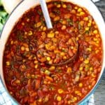 Smoky Vegetarian Chili | Filled with mushrooms and beans, this vegan chili is delicious, filling, and nutrient-packed. But what really makes this chili really stand on its own is the secret spice combination that makes it smoky, velvety, and spicy