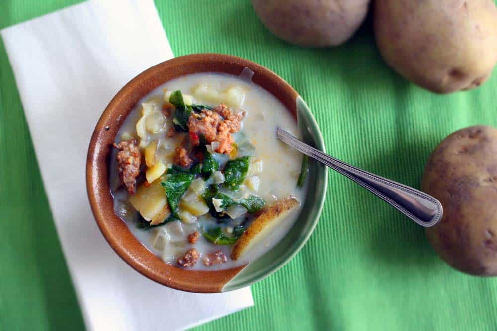 The Olive Garden's famous Zuppa Toscana made 100% real/unprocessed! A creamy soup with hot Italian sausage, potatoes, and spinach.