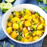 A white bowl with Mango Salsa in it.