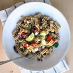 Antipasto Pasta Salad | This pasta salad is DELICIOUS, easy to make in bulk, and is served cold so it can be made ahead of time and pulled right out of your fridge before serving. The dressing makes for a salty-sweet flavor combination that's awesome for a hot summer's day. Plus, it's 100% real, clean, and unprocessed!