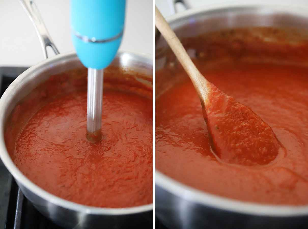 Using an immersion blender to puree homemade enchilada sauce.