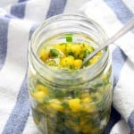 Easy Mango Salsa | An easy mango salsa recipe that's delicious on fish or chicken, in tacos, on rice, or with your favorite Mexican inspired dish! No special equipment needed- just chop and combine.