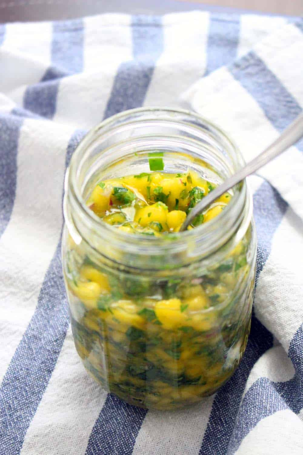 An easy mango salsa recipe that's delicious on fish or chicken, in tacos, on rice, or with your favorite Mexican inspired dish! No special equipment needed- just chop and combine.