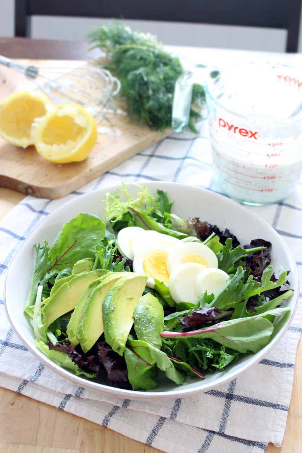 Mixed Greens Salad with Egg and Avocado | A refreshing, filling, and flavorful salad with a simple homemade dressing. Great to take to work for a healthy, satisfying lunch-on-the-go!