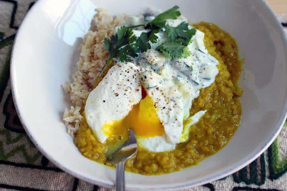 Red Lentil Dal with Poached Eggs and Cucumber Yogurt Sauce | This vegetarian recipe is fresh, healthy, and bursting with flavor. Makes for an impressive brunch!