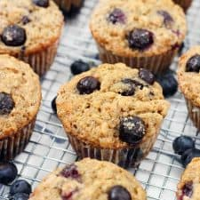 Close up of blueberry banana oat muffins on a cooling rack.