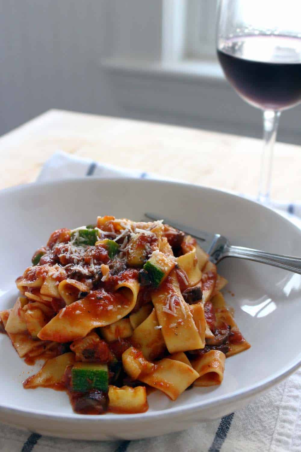 Pappardelle with Zucchini Mushroom and Marainara | A super quick and easy meal for a busy weeknight- just saute zucchini and mushrooms, add marinara sauce, and add cooked pasta! A healthy, tasty, cheap vegetarian meal.