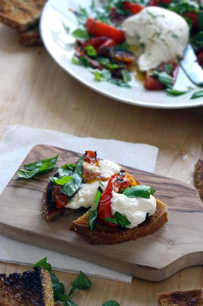 Roasted Tomato and Burrata Caprese Salad   You don't need to go to an Italian restaurant to enjoy this decadent Caprese salad! Burrata (a cream-filled fresh mozzarella) is paired with roasted tomatoes and served with garlic toast for a rich, delicious appetizer.