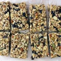 Bird's eye view of a sheet of granola bars that has been cut into eighths.