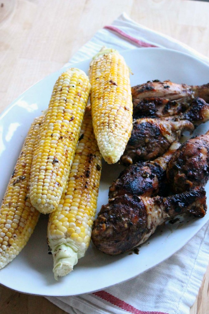 Jamaican Jerk Chicken and Corn | This jerk seasoning is BURSTING with amazing Caribbean flavors- spicy, savory, salty, sweet, and extremely aromatic with the addition of allspice, cinnamon, and nutmeg. Use the seasoning on grilled chicken, fish, or vegetables, or mix with melted butter and brush on corn on the cob. You will want to put it on EVERYTHING!