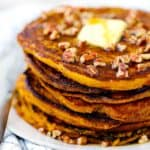 Close up photo of a stack of pumpkin pancakes.
