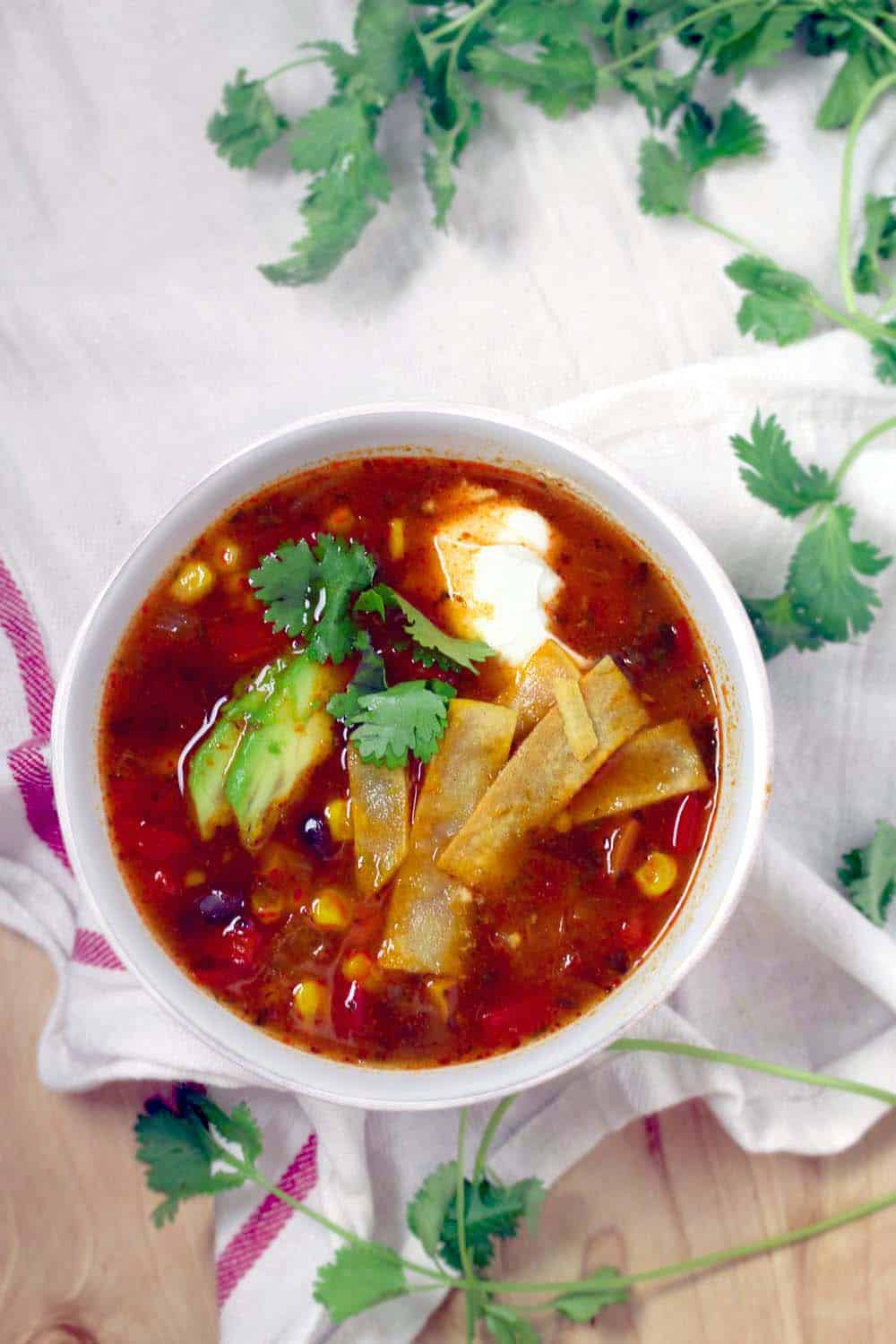 A healthy and delicious vegetarian/vegan tortilla soup loaded with vegetables and topped with guilt-free fixings.