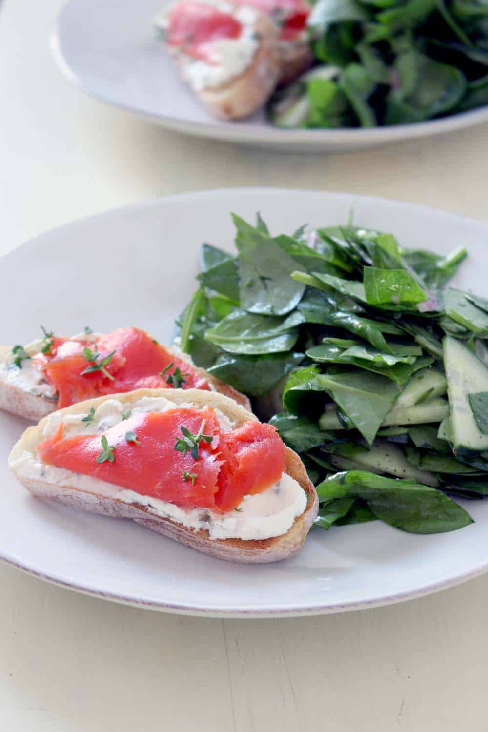 Smoked Salmon and Caper Cream Cheese Toast | Capers, onions, and spices are mixed together with cream cheese, spread on toast, and topped with smoked salmon. Perfect for breakfast, a light lunch or dinner, or as a party appetizer!