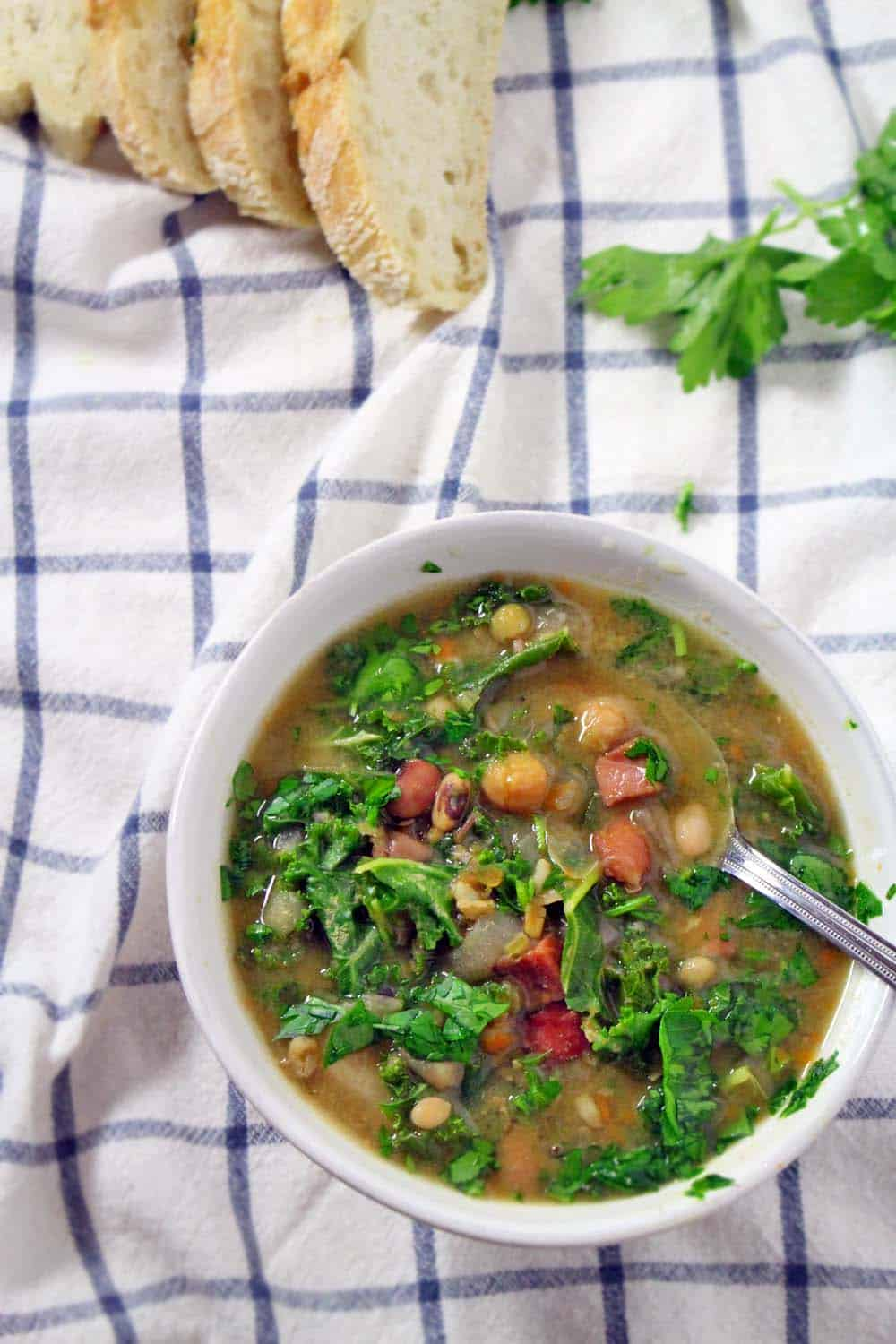 This 16 bean and kale soup is a nutrient-packed, easy, hearty, and delicious meal! Slow cooking makes it super easy. Freeze the leftovers!