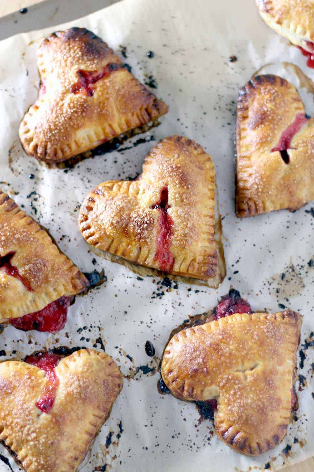 Not only are these mini strawberry ginger hand pies adorable for Valentine's day, but they use very little refined sugar and are the perfect balance of tart and sweet!