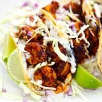Square photo of shrimp tacos.