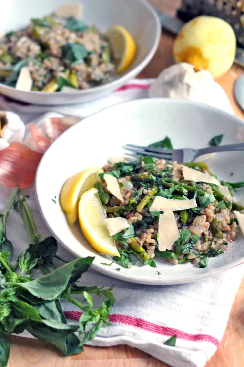 This Barley Risotto with Asparagus, Basil, and Lemon is a bright and healthy spring dish- made with 100% whole grains and a special trick that cuts the cooking time of barley in half!