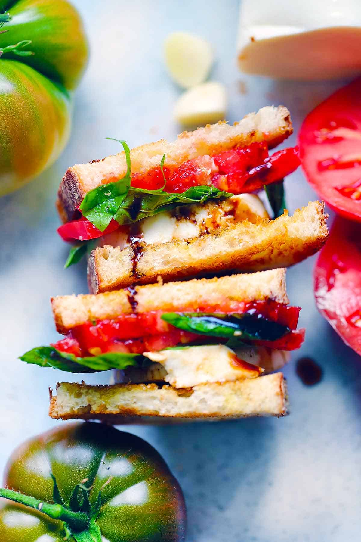 These Caprese sandwiches are my absolute favorite vegetarian sandwich, topped with EVOO and a sweet and tangy balsamic glaze.