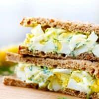 Close up egg salad sandwich photo.