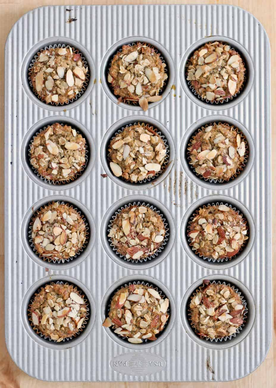 Bird's eye view of a muffin pan, filled with Maple Banana Oat and Nut Muffins.