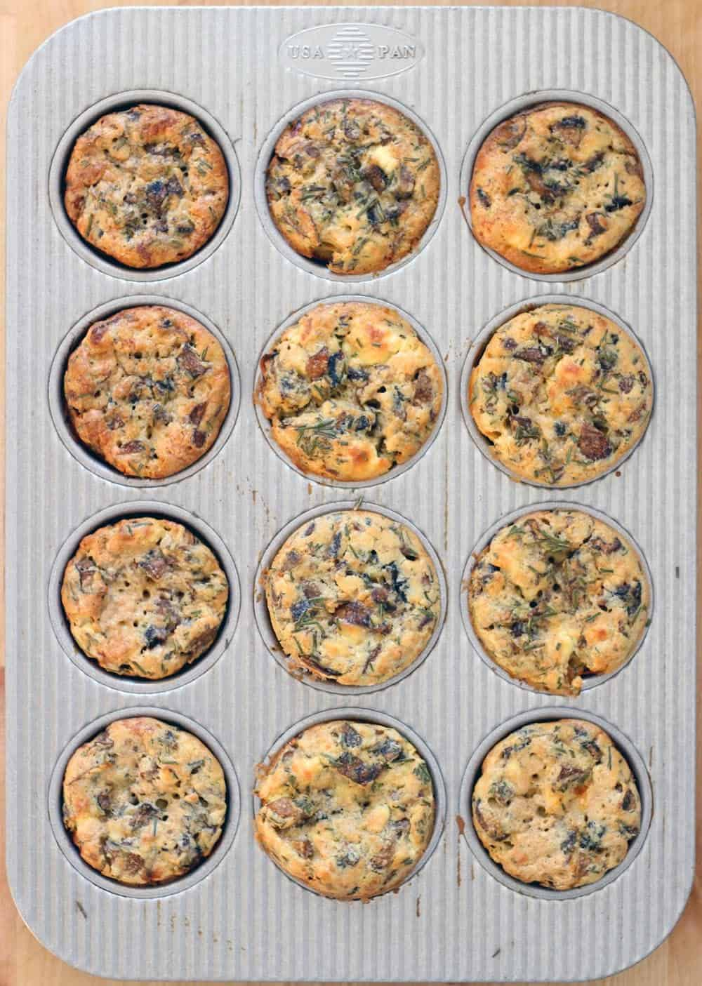 Bird's eye view of a muffin pan filled with mini quiches.