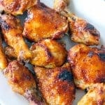 A platter of oven bbq chicken thighs and drumsticks